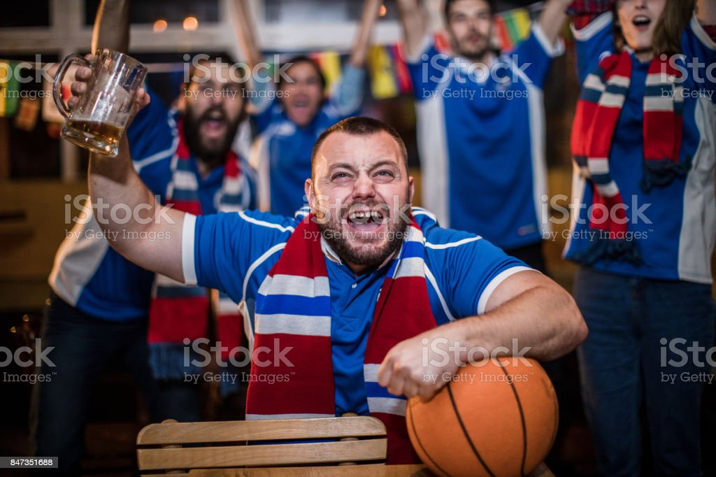 Fans watching basketball stock photo
