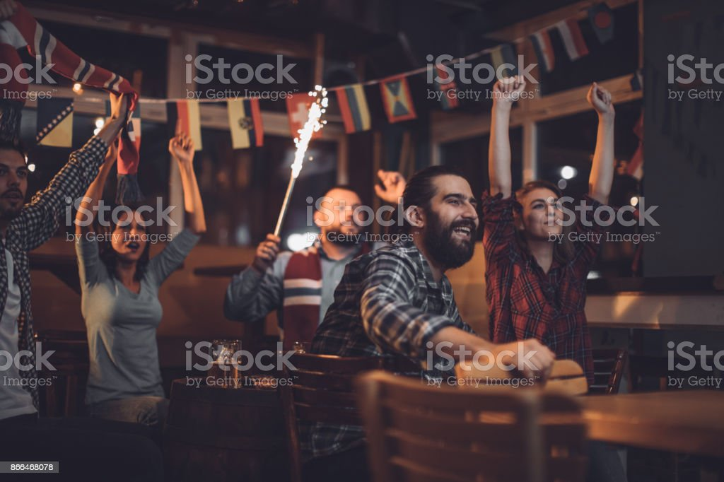 Fans watching the game stock photo