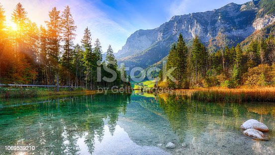 Fantastic autumn sunset of Hintersee lake. Beautiful scene of trees near turquoise water of Hintersee lake. Location: resort Ramsau, National park Berchtesgadener Land, Upper Bavaria, Germany Alps, Europe