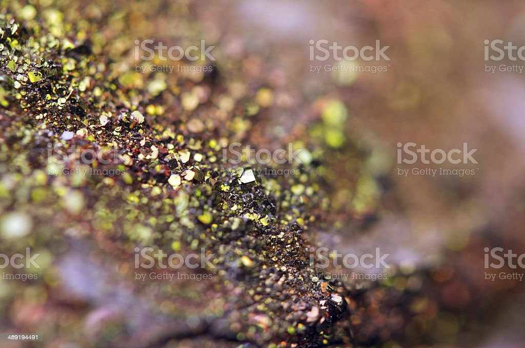 Fantastic background, magic of a stone, rainbow in metal rock stock photo