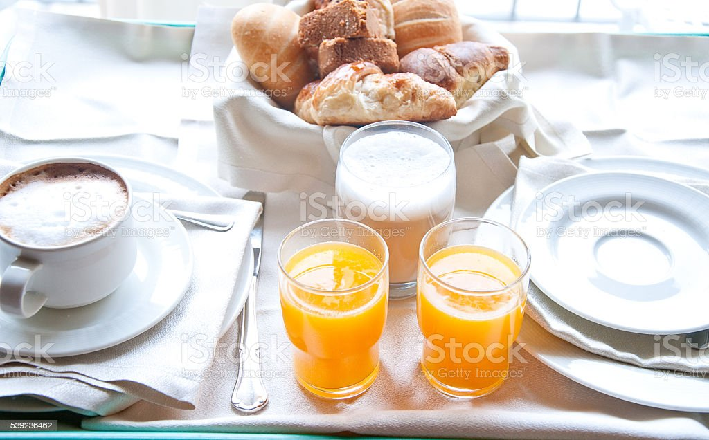Fantastic breakfast of cappuccino, croissants , orange juice an