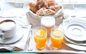 Fantastic breakfast of cappuccino, croissants , orange juice an