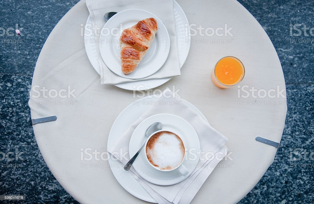 Fantastic breakfast of cappuccino, croissants , orange juice an royalty-free stock photo