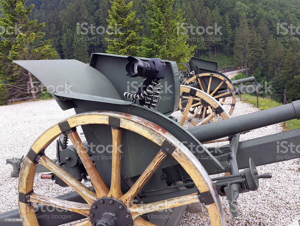 fantastic camera tripod over an old World War I Cannon stock photo