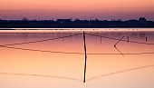 A series of landscapes of a salt lake in a seaside resort after sunset.
