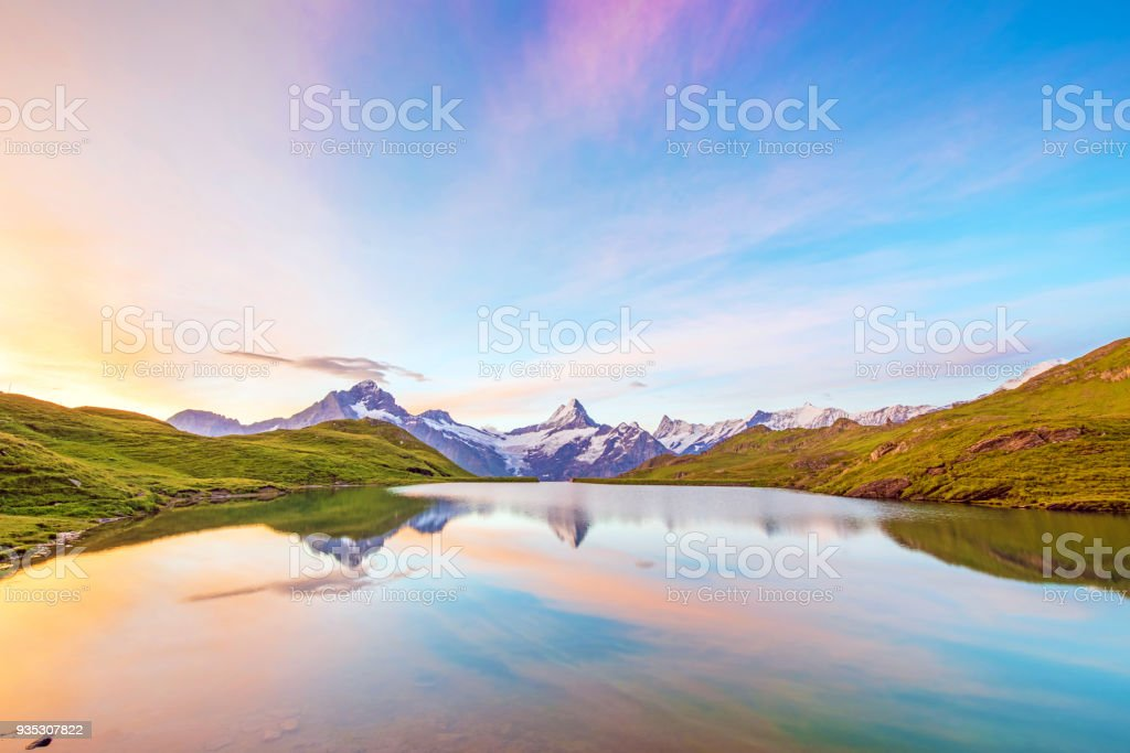 Fantastic landscape at sunrise over the lake in the Swiss Alps, Europe. Wetterhorn, Schreckhorn, Finsteraarhorn et Bachsee. ( relaxation, harmony, anti-stress - concept). stock photo
