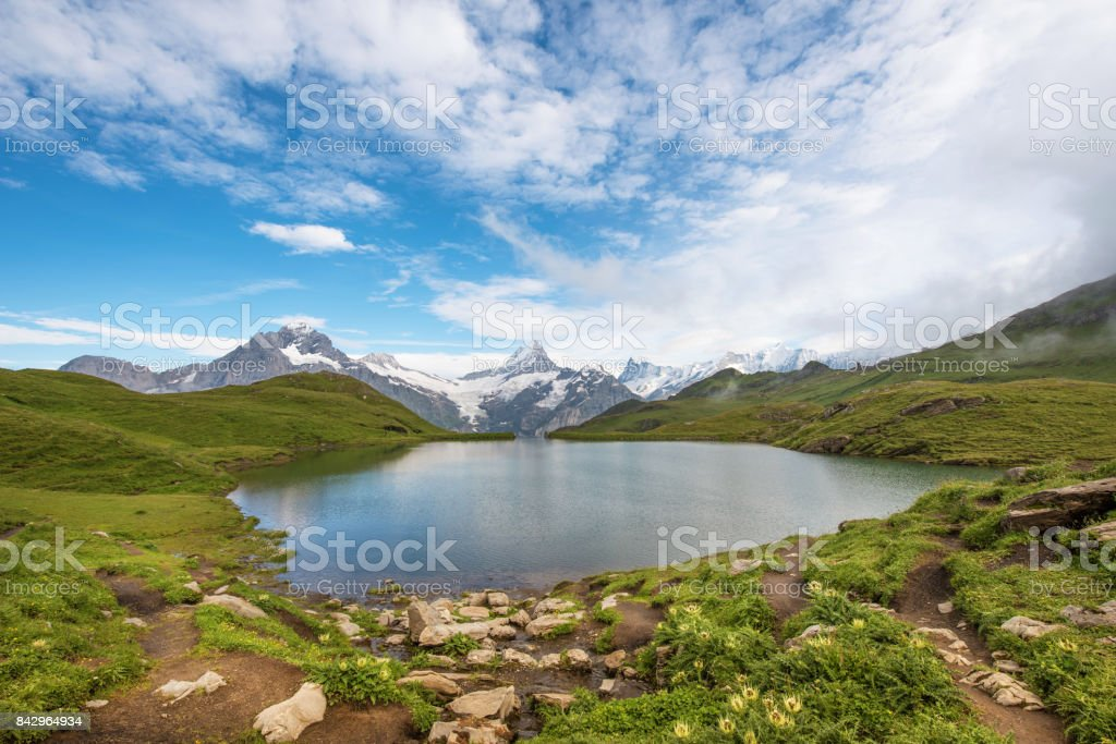 Fantastic landscape with lake in the Swiss Alps, Europe. Wetterhorn, Schreckhorn, Finsteraarhorn et Bachsee. (Landscape, relaxation, tourism, anti-stress - concept). stock photo