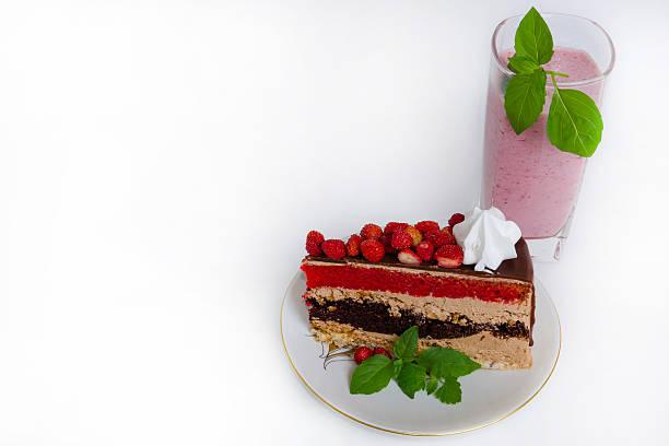 Fantastic layered cake with roses and milk shake stock photo