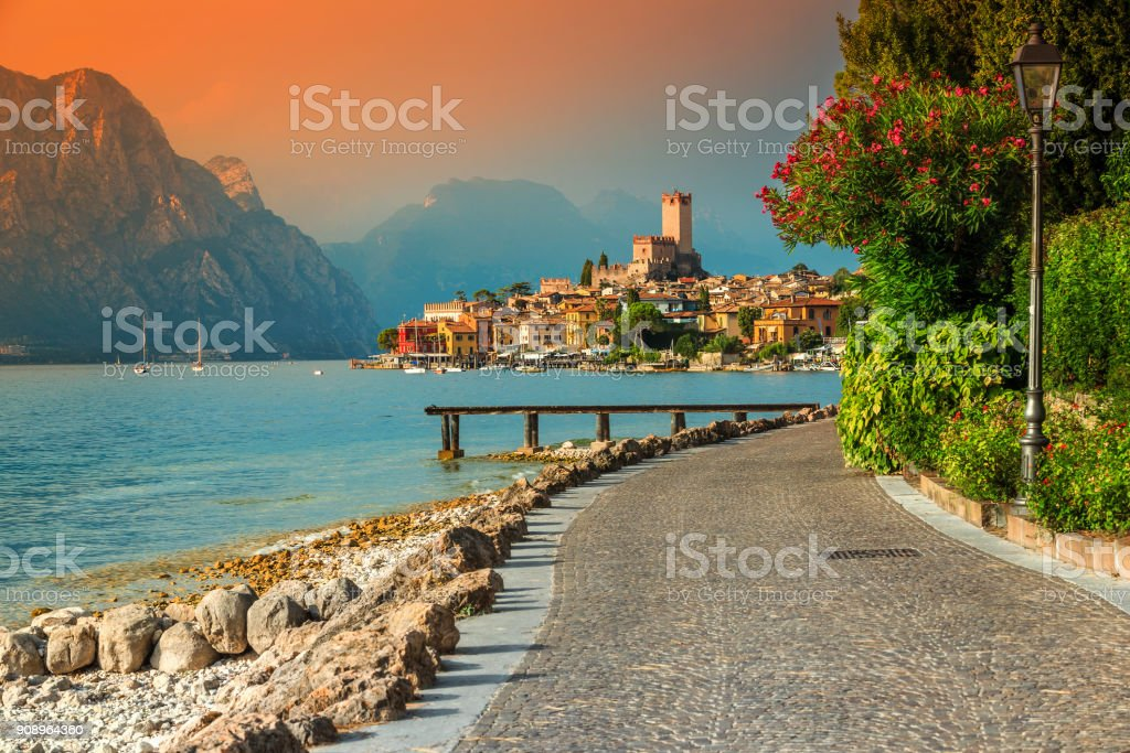 Fantastic Malcesine tourist resort and colorful sunset, Garda lake, Italy stock photo