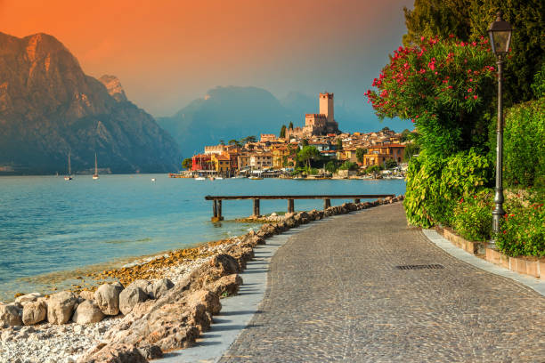 Fantastic Malcesine tourist resort and colorful sunset, Garda lake, Italy stock photo