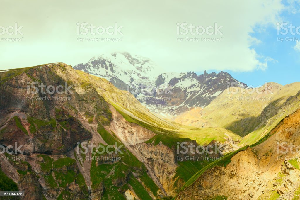 Fantastic mountain landscape with green meadows stock photo