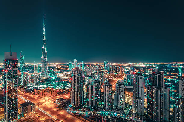 Fantastic nighttime skyline of a big city with illuminated skyscrapers stock photo