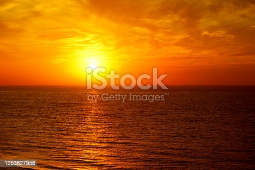 Fantastic ocean and sunset sky in bright red colors.