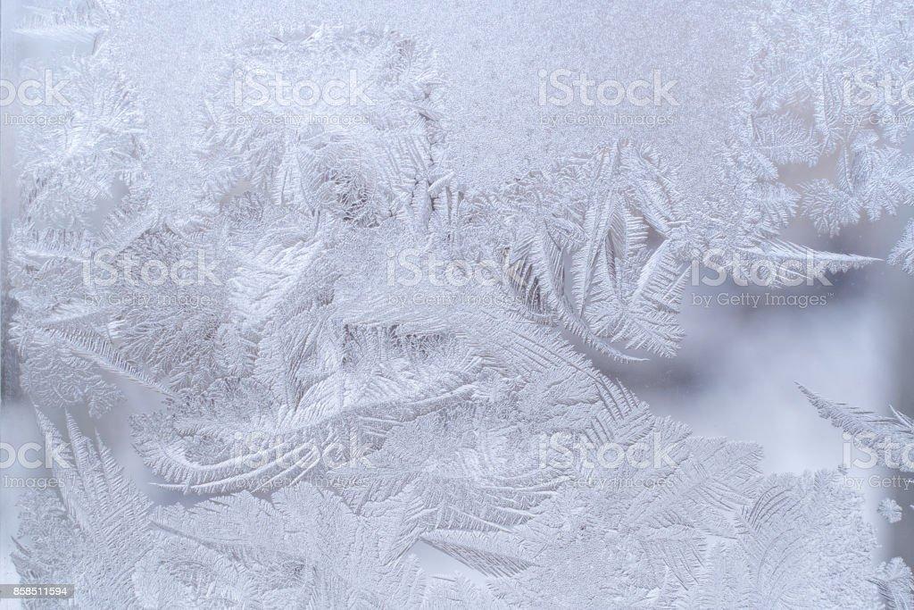 Fantastic ornate frosty pattern on winter window glass. stock photo