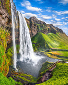 Fantastic Seljalandsfoss waterfall in Iceland during sunny day. Location: Seljalandsfoss waterfall, part of the river Seljalandsa, Iceland, Europe
