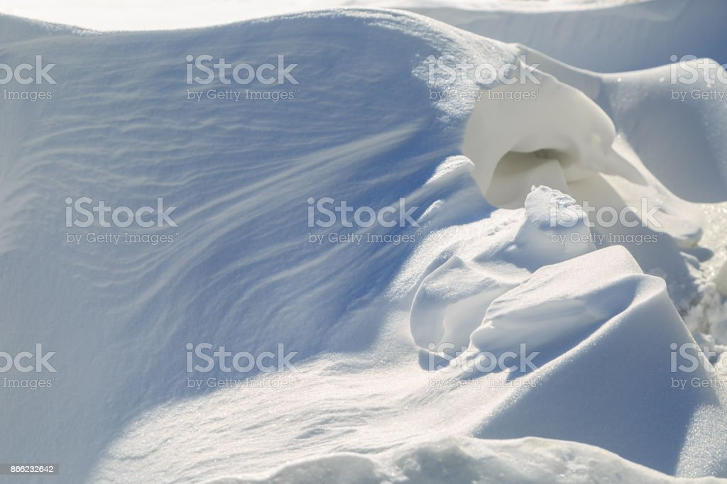Fantastic snowdrift on a winter sunny day stock photo