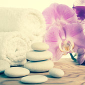 fantastic Spa still life with stone, lilac orchid and towel, vintage style