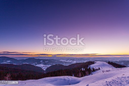 Fantastic starry sky. Winter landscape and snow-capped peaks. Carpathian mountains. Ukraine. Europe.