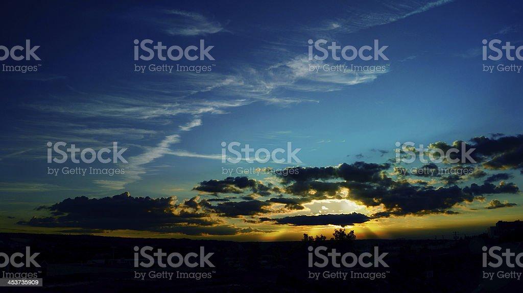 Fantastic sun rays striking through clouds - Beautiful Vibrant royalty-free stock photo