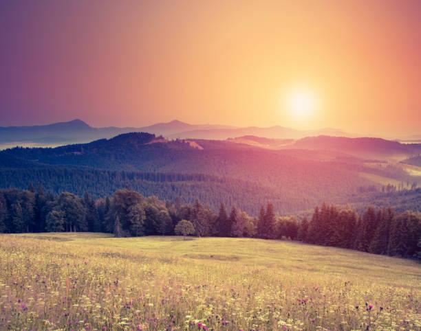 Fantastic sunny hills under morning sky.