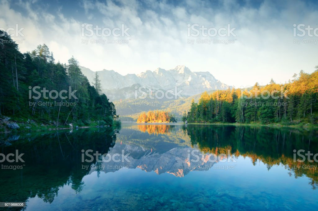 Fantastic sunrise on mountain lake Eibsee stock photo