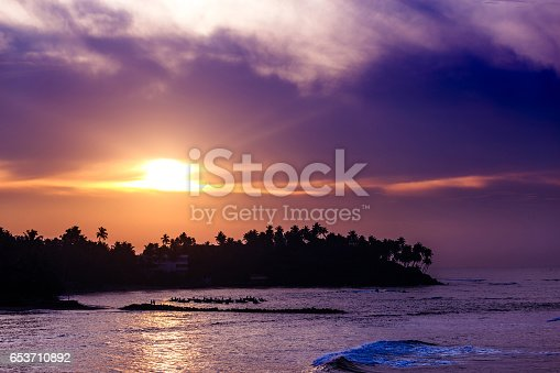 istock Fantastic sunset on the beach 653710892