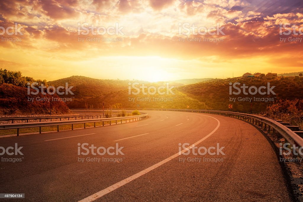fantastic sunset over asphalt road stock photo