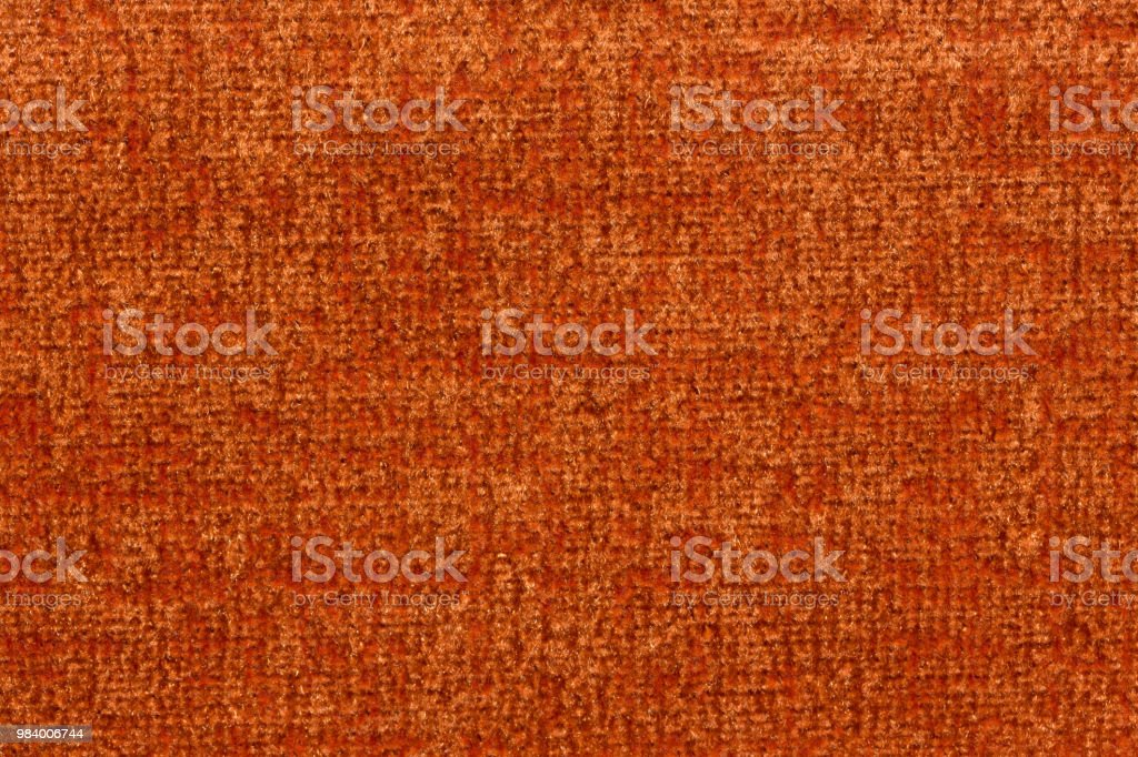 Fantastic textile background in saturated orange colour. High...