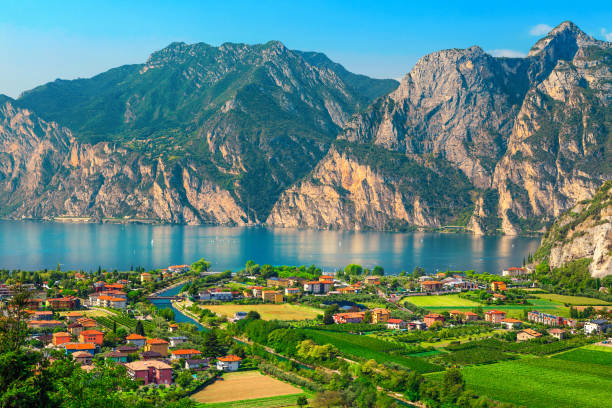 Fantastic Torbole cityscape with plantations and lake Garda, Italy, Europe stock photo