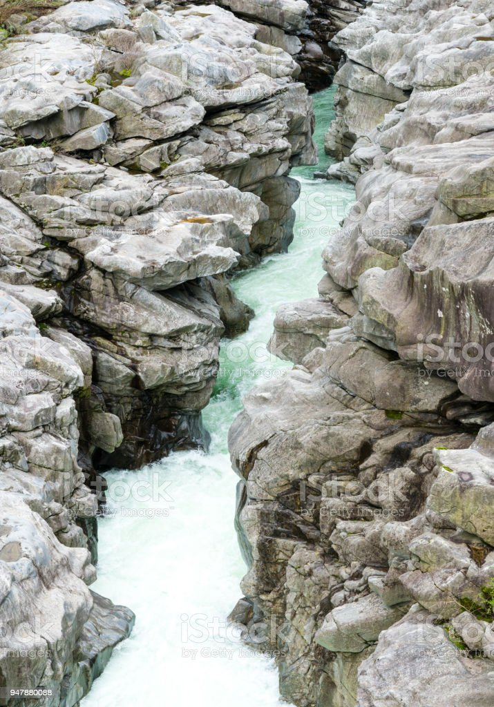 fantastic view of the Maggia river carving ist way through a wild rocky gorge stock photo