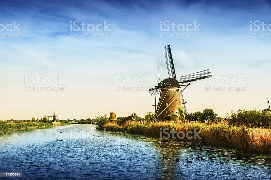 Fantastic view of Windmills at sunset royalty-free stock photo