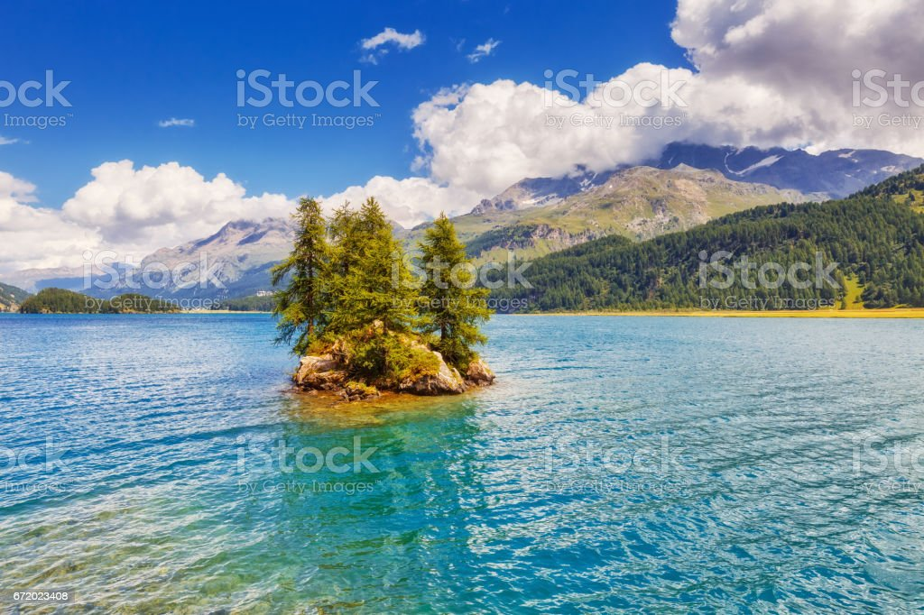 Fantastic view on turquoise water Silsersee lake (Sils) including Piz Corvatsch in the Swiss Alps. stock photo