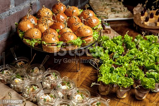 istock Fantastic wedding banquet table with awesome decor and delicious dishes. 1141996072