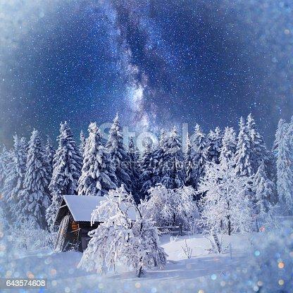 1140293905 istock photo fantastic winter landscape. Chalet under the stars. background w 643574608