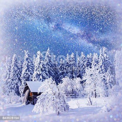 1039894076 istock photo fantastic winter landscape. Chalet under the stars. background w 643578154