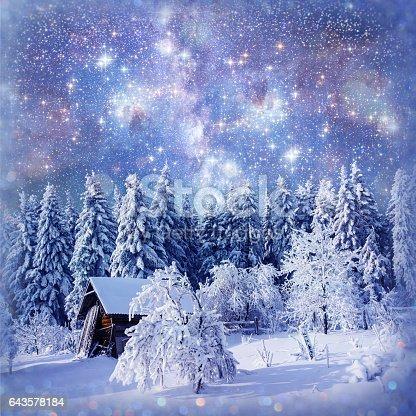 1039894076 istock photo fantastic winter landscape. Chalet under the stars. background w 643578184