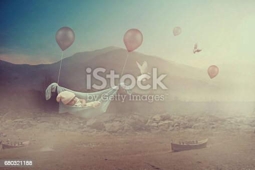 istock Fantasy - Adorable baby flying with balloons in a valley 680321188