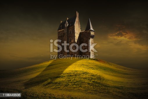 Fantasy castle behind the green grass hill. Lighting scene under the moody sky.