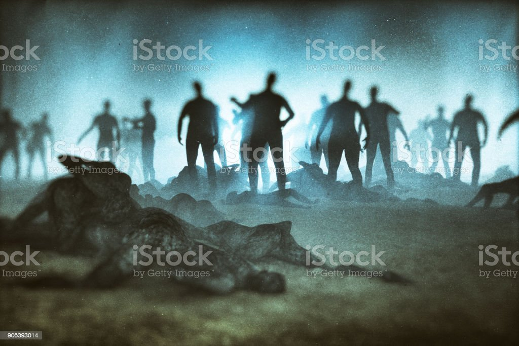 Fantasy character against zombie hordes stock photo