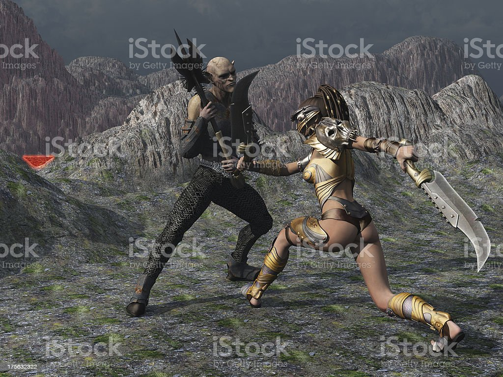 Fantasy female warrior faces goblin in the mountains stock photo