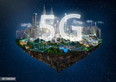 istock Fantasy island floating in the air with 5G network wireless systems and internet of things , Smart city and communication network concept . 921560304
