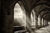 istock fantasy monastery archway with view to ocean an sunrays 826657858