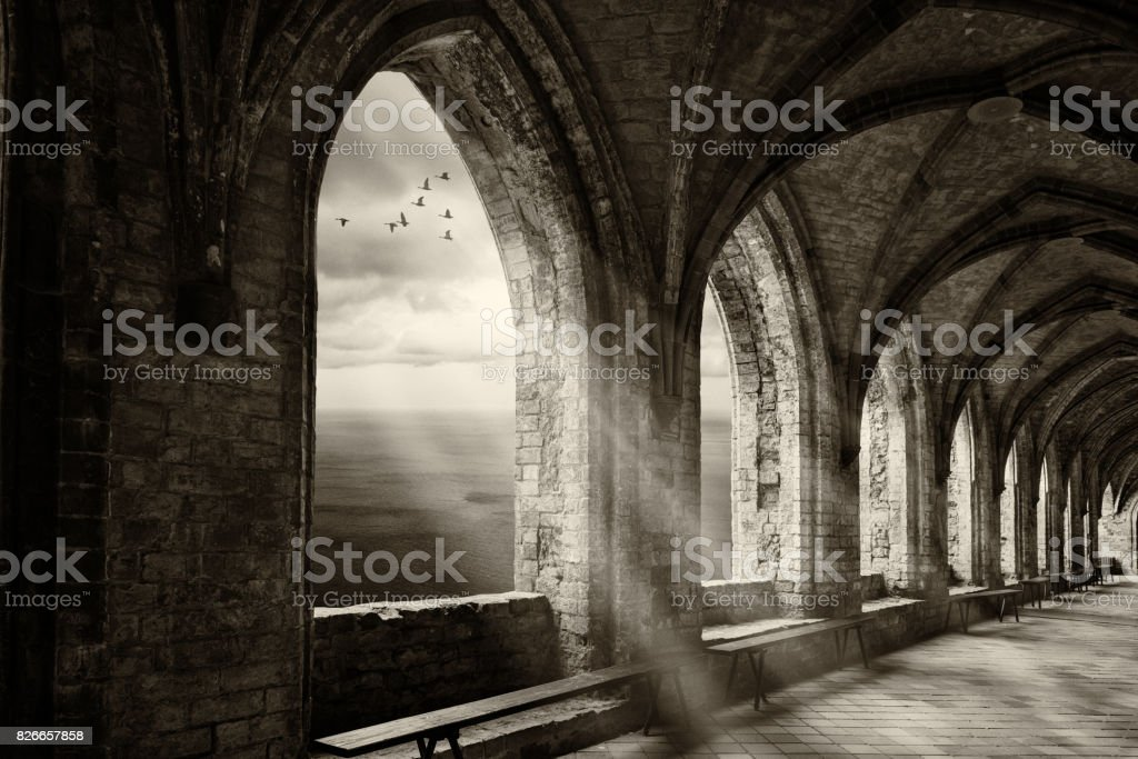 fantasy monastery archway with view to ocean an sunrays stock photo