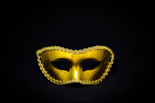 fantasy mystery golden mask isolated on black background - halloween & murder concept. - murder mystery stock photos and pictures