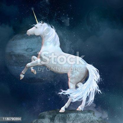 istock Fantasy unicorn over a rock 1130790354