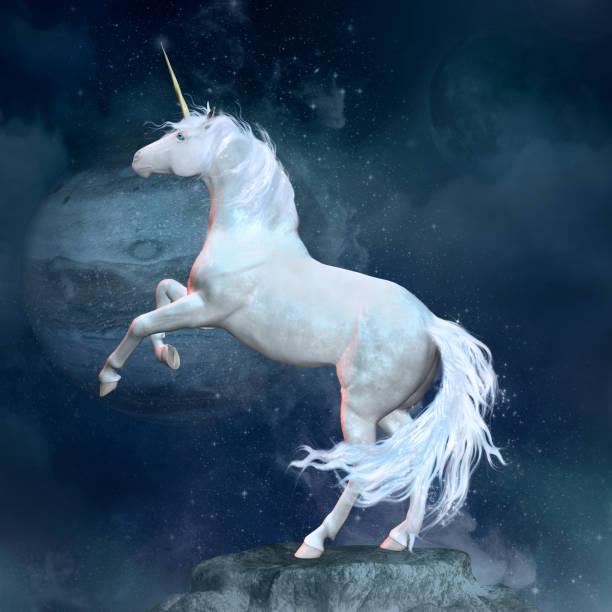 Fantasy unicorn over a rock stock photo