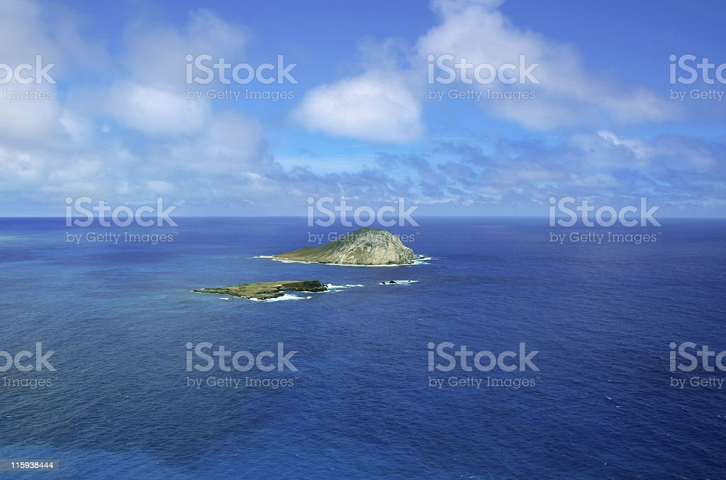 A far away picture of an island in the middle of water royalty-free stock photo