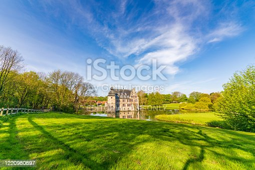 Dortmund, Germany - Apr 12, 2019: Far distance view of the castle on water Bodelschwingh in Dortmund, Germany