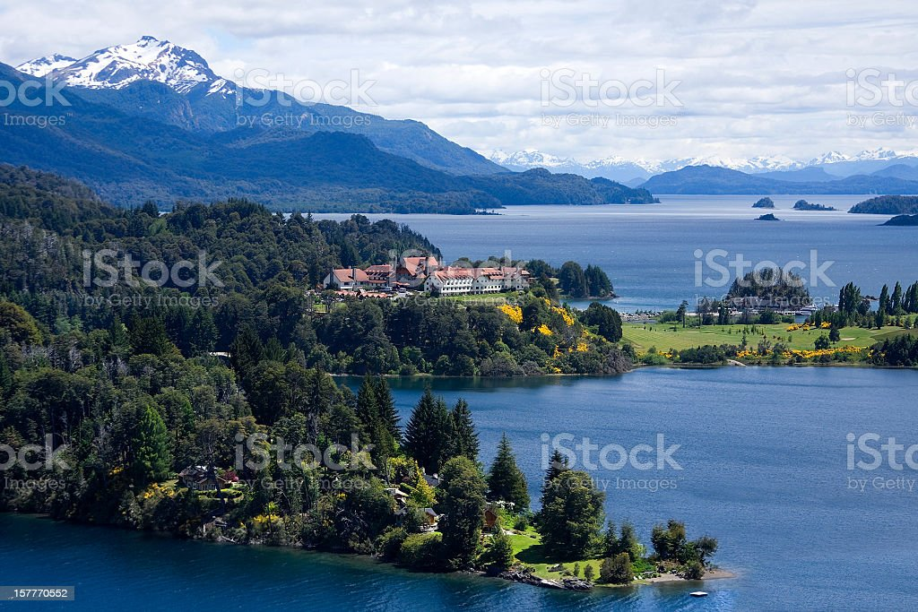 Far panoramic of forest resort near the water and mountains stock photo