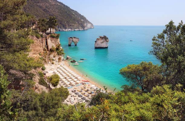 Faraglioni di Puglia Baia delle Zagare. Travel Italy stock photo